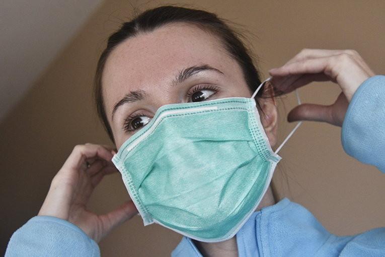 Как правильно надевать и носить медицинскую маску и какой стороной
